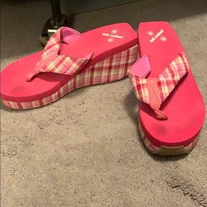 """Hot pink """"not rated"""" plaid flip flops"""